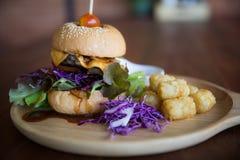 Disco del cheeseburger fotografía de archivo