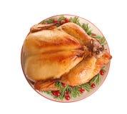 Disco del pavo cocinado con la guarnici?n en el fondo blanco foto de archivo