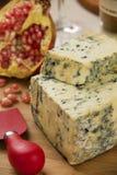 Disco del queso del abastecimiento con y granada fresca Fotografía de archivo libre de regalías