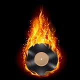 Disco del vinilo en llamas del fuego. Fotografía de archivo libre de regalías