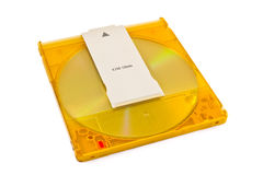Disco di DVD-RAM in cartuccia di plastica su bianco Fotografia Stock Libera da Diritti