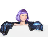Disco diva. In a very shiny purple wig with a board left blank for your message Stock Image