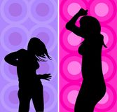Disco divas. Silhouettes of young women dancing against colourful retro background Royalty Free Stock Images