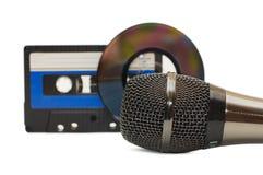 Disco do microfone e do dvd isolado Fotos de Stock