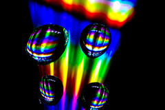 Disco drops. Drops on a cd, shined on with a led light, giving a very colourful effect Stock Images