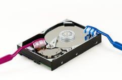 Disco duro aberto com duas escovas de dentes Imagens de Stock Royalty Free