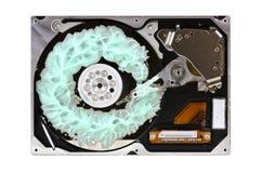 Disco duro abierto con crema dental de la turquesa Imágenes de archivo libres de regalías