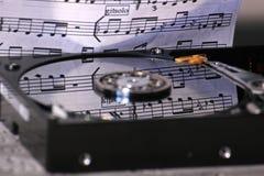 Disco duro con música Imagenes de archivo