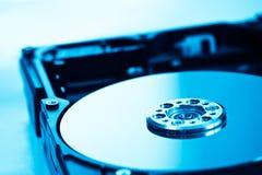 Disco duro en luz azul Fotos de archivo libres de regalías