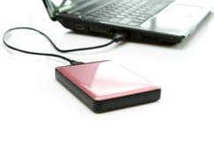Disco duro externo rosado en blanco Imagen de archivo