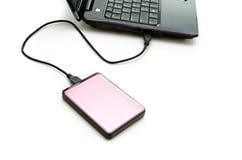 Disco duro externo rosado en blanco Foto de archivo libre de regalías