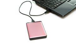 Disco duro externo rosado en blanco Fotos de archivo libres de regalías