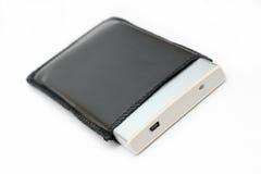 Disco duro portable externo en la cubierta de cuero Fotos de archivo