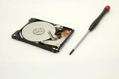 Disco duro y destornillador Imagen de archivo