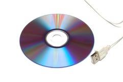 Disco en blanco de CD-DVD y cable blanco del USB Foto de archivo