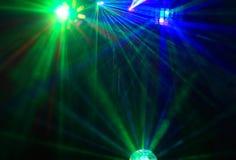 Disco. Exposition de laser. Photographie stock libre de droits