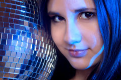 Disco girl. Portrait of young girl with disco ball Royalty Free Stock Photography