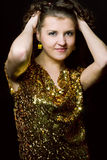 Disco girl. Sexy disco girl with golden dress Stock Photography