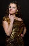 Disco girl. With golden dress Royalty Free Stock Photography