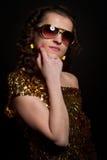 Disco girl. With golden dress Royalty Free Stock Photos