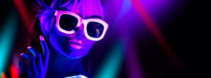 Free Disco Girl In Neon Light Dancing In Night Club. Fashion Model Woman. Closeup Portrait Of Beautiful Girl With Fluorescent Make-up Stock Photo - 193119270