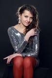 Disco girl in silver dress Stock Image