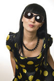 The disco girl in sun glasses sends an air kiss Royalty Free Stock Photos