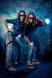 Disco girls. Modern hip-hop dancers over grunge background. Urban, disco style Stock Images