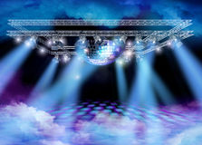 Disco heaven spectacle. Disco mirror ball, lights truss construction and color smoke on floor and ceiling Royalty Free Stock Photography