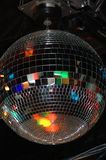 Disco inferno. A disco mirror ball reflecting lights in a night club Royalty Free Stock Images