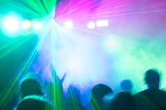 Disco laser lihgts illuminating crowd. Stock Images