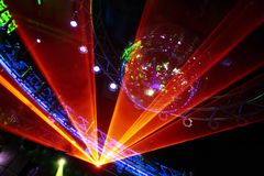 Disco Laser Show. Fantastic Orange Laser Show at the Disco Royalty Free Stock Images