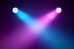 Disco lights. Purple and blue searchlights in the smoke-filled darkness Royalty Free Stock Photography