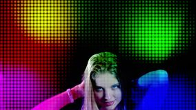Disco lights and led light stage screen with dancing woman. In night club