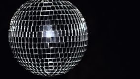 Disco mirror ball at black background with copyspace with glares. 4k UHD stock video