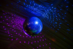 Disco mirror ball in blue light, party Stock Photography