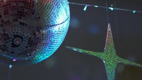 Disco mirror ball. Blue sphere or colorful disco mirror ball reflecting light spots and hanging on the ceiling in the dark of night club or pub. Retro party in stock video