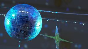 Disco Mirror Ball. Blue sphere or colorful disco mirror ball reflecting light spots and hanging on the ceiling in the dark of night club or pub. Retro party in stock footage