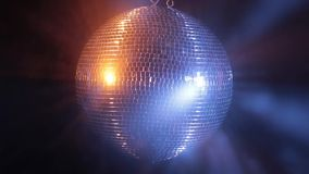 Disco mirror ball reflect very bright blue and red light stock video footage