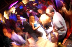 Disco Night Club Dancing People. Abstract close up motion blur colourful image of happy dancing people in a disco night club. Used camera panning technique and royalty free stock image