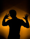 Disco party. Back lit silhouette of dancing man Royalty Free Stock Photos