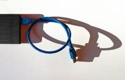 Disco rígido externo com sombra longa Imagens de Stock Royalty Free