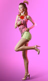 Disco redhead girl with big lollipop smiling and dancing Royalty Free Stock Images