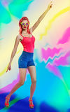 Disco redhead girl in glasses dancing. Art Stock Photography