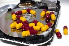 Disco rigido con la pillola Fotografia Stock Libera da Diritti