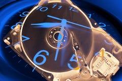 Disco rigido del calcolatore e dell'orologio fotografia stock libera da diritti