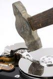 Disco rigido del calcolatore sotto il martello Fotografie Stock