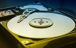 Disco rigido del computer con la testa di lettura fotografia stock