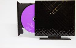 Disco roxo do CD na movimentação preta imagens de stock royalty free