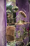 Disco sphere. The scattered chairs and glasses, champagne bottles. Exposition. Decorative show-window. Pink colors. Chaos. stock photography